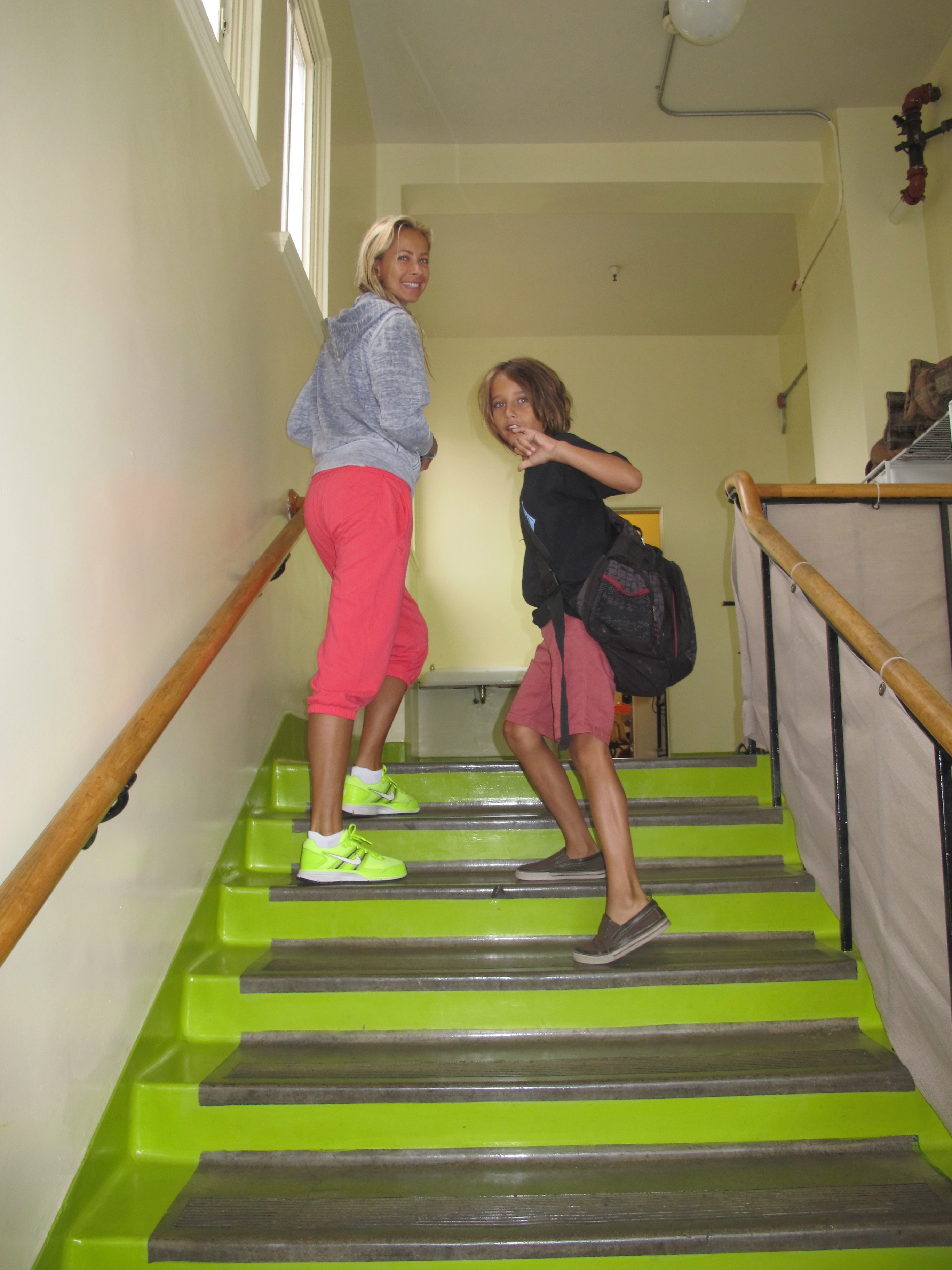 My son, Kaleo and I running up the stairs to his classroom.